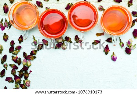 Rose tea and flower petals on white background isolated #1076910173