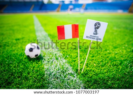 MOSCOW, RUSSIA - APRIL, 24, 2018: Peru national flag and Official logo of Football FIFA World Cup 2018 in Russia. #1077003197