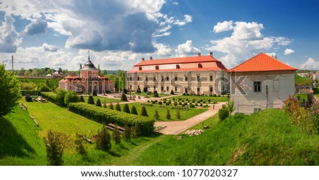 View of the old castle on sunny day against the blue sky in Zolochiv, Lviv region in Ukraine. #1077020327