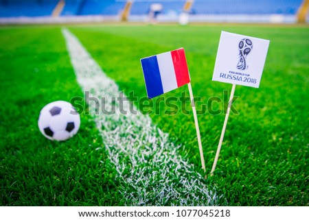 MOSCOW, RUSSIA - APRIL, 24, 2018: France national flag and Official logo of Football FIFA World Cup 2018 in Russia. Green grass, edit space in background. #1077045218