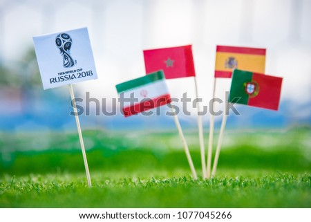 MOSCOW, RUSSIA - APRIL, 24, 2018: Group B - National flags of Portugal, Spain, Morocco, IR Iran and Official logo of FIFA World Cup 2018 in Russia. and Russian national flag. White background, #1077045266