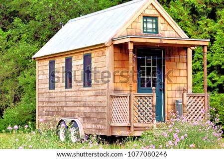Tiny house with porch Royalty-Free Stock Photo #1077080246