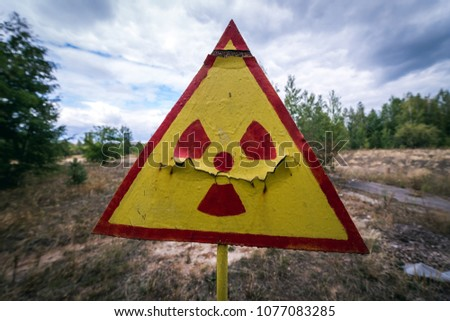 Radiation sign on a graveyard in abandoned Pripyat city in Chernobyl Exclusion Zone, Ukraine #1077083285
