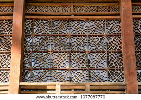 Shaki, Azerbaijan - August 13, 2017. Exterior view of stained-glass window with geometric patterns at the Palace of Shaki Khans, dating from 1762. #1077087770