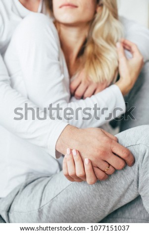 Sensitive couple portrait embrace and holding each other hands. Close-up #1077151037