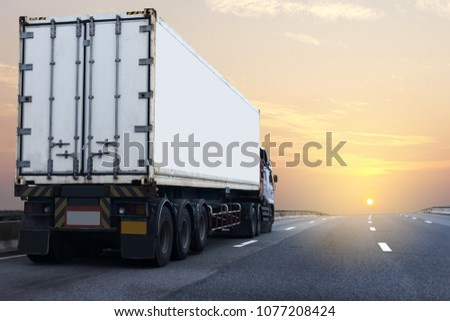 Truck on highway road with white container, transportation concept.,import,export logistic industrial Transporting Land transport on asphalt expressway with sunrise sky #1077208424