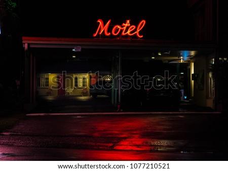 Nighttime shot of vintage small motel on a rainy night #1077210521