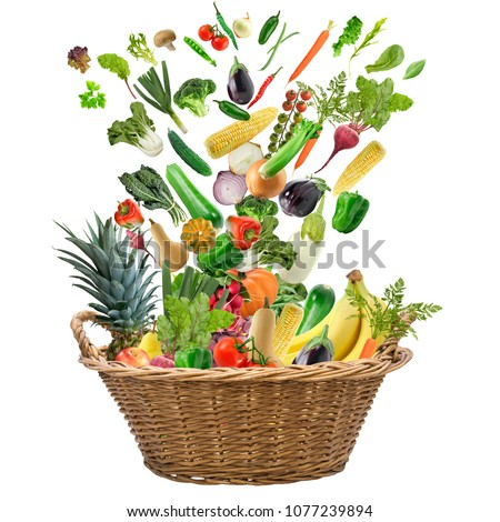 Fresh fruits and vegetables in a basket isolated on white background #1077239894