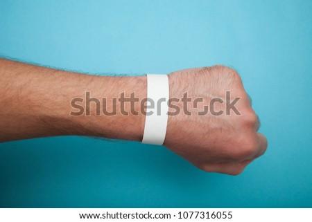 Mockup paper white bracelet on the arm. #1077316055