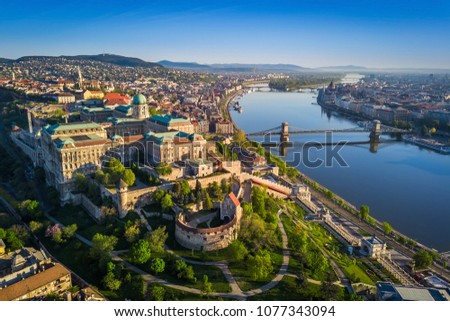 Budapest, Hungary - Beautiful aerial skyline view of Buda Castle Royal Palace and South Rondella at sunset with Szechenyi Chain Bridge over River Danube, Matthias Church and Parliament of Hungary #1077343094