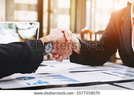 Sealing a deal, Business man and woman handshake  to business  agreement. #1077358070