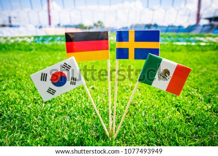 Group F - Germany, Mexico, Sweden, Korea Republic, South Korea - National Flags on green grass on football stadium #1077493949
