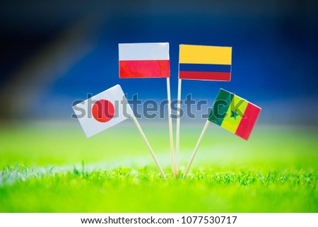 GROUP H draw in Russia 2018  - Poland, Senegal, Columbia, Japan national Flag and football ball on green grass. Fans, support photo, edit space. Original wallpaper for Football World Cup, Russia 2018 #1077530717