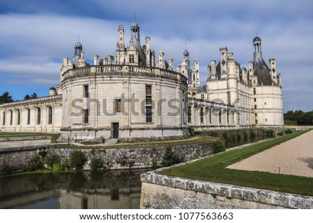 External view of Chambord castle (1519) - largest of Loire Chateau. It distinct French defensive architecture combines with classical Italian. Chambord, France. #1077563663