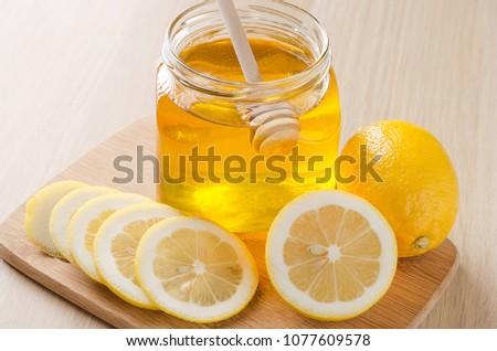 Lemon and honey on a dark light background #1077609578