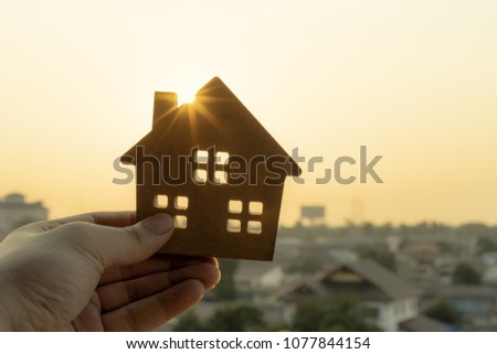 House model in home insurance broker agent 's hand or in salesman person. Real estate agent offer house, property insurance and security, affordable housing concepts #1077844154