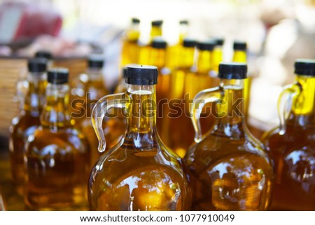 glass bottles of home made natural olive oil with backlight  #1077910049