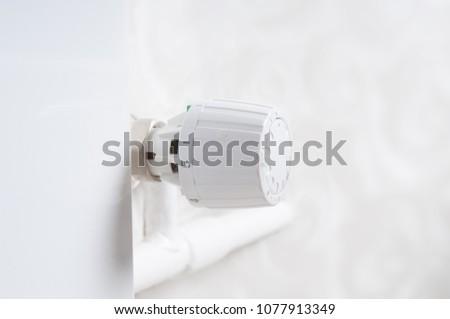 Temperature knob of heating radiator close up #1077913349