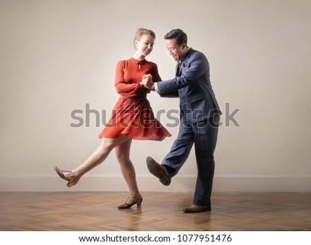 Dancers dancing together, dressing up with vintage clothes #1077951476