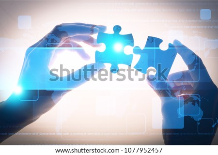 Pieces of jigsaw puzzle in hands #1077952457