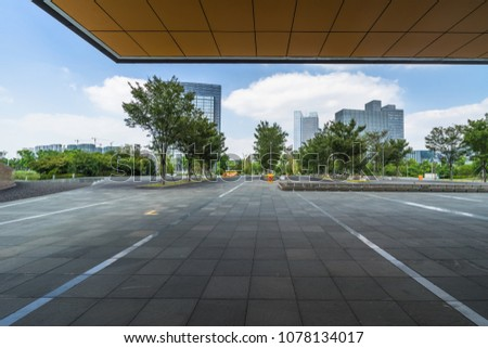 modern buildings and empty pavement in china #1078134017