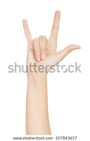woman hand giving the devil horns gesture (isolated on white background) Royalty-Free Stock Photo #107843657