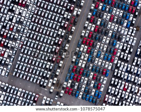 Aerial top view photo from flying drone, New Cars produced Several times a year at industrial estate for import export around in the world  #1078575047