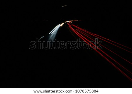 light trails on highway at night, long exposure photo #1078575884
