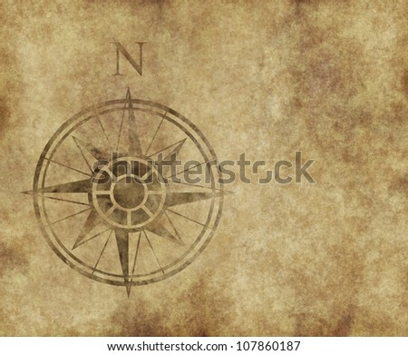 great north arrow and compass on old parchment map with copy space #107860187
