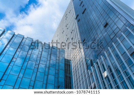 Clouds Reflected in Windows of Modern Office Building #1078741115