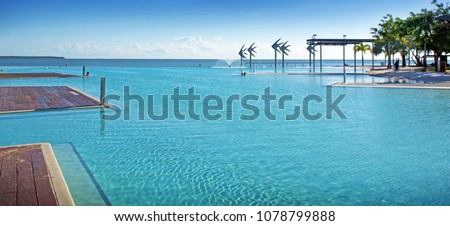 Stunning public swimming pool - Cairns Lagoon - on the edge of the Coral Sea in Cairns Australia  #1078799888