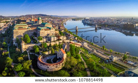 Budapest, Hungary - Aerial panoramic skyline view of Buda Castle Royal Palace with Szechenyi Chain Bridge, St.Stephen's Basilica, Hungarian Parliament and Matthias Church at sunrise with blue sky #1078814498