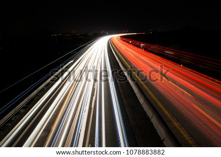 light trails on highway at night, long exposure photo #1078883882