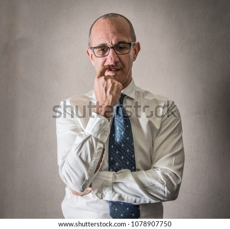 a Man in shirt and tie having doubts  #1078907750