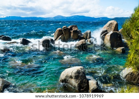 Windy Day on Lake Tahoe, Blue Water, Pine Tree and Snowcapped Mountains. Sand Harbor, Nevada. #1078919969