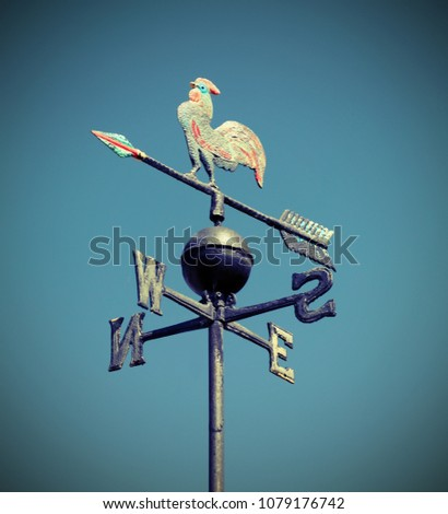 weathervane also called weathercock with vintage effect and blue sky on background #1079176742