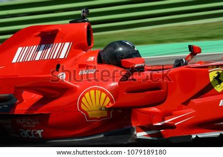 IMOLA, Italy 20 april 2018: unknown run with modern Ferrari F1 F2007 ex Kimi Raikkonen and Felipe Massa at Imola Circuit during Motor Legend Festival 2018. Italy. #1079189180