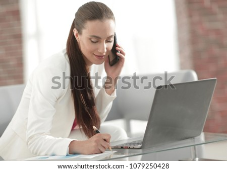 business woman working with financial documents #1079250428