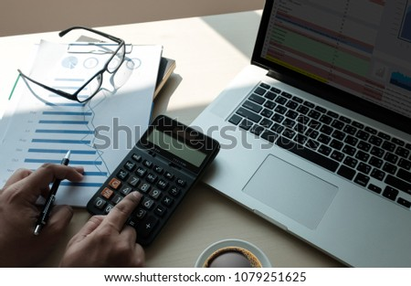 Close up businessman using calculator on documents Unrecognizable finance  use calculate about cost at office #1079251625