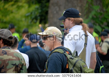 CHARLOTTESVILLE, VA - August 12, 2017: Members of a white supremacist group at a white nationalist rally that turned violent resulting in one death and multiple injuries. #1079261606