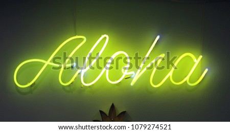Aloha written on neon sign