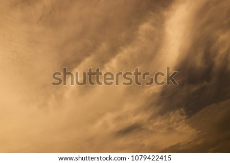 A large storm formed, powdered dust and sand on the ground were blown into the clouds, causing the orange glow to look horrible. extreme weather events. Royalty-Free Stock Photo #1079422415