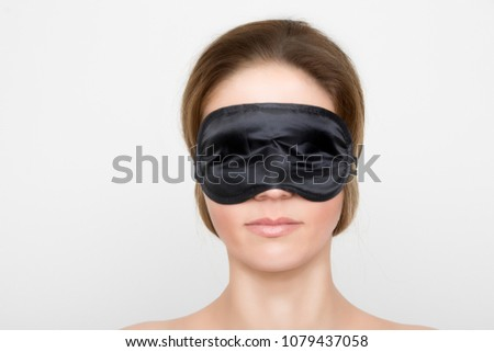 Gorgeous woman with black sleep mask #1079437058
