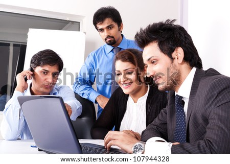 group of multi racial business people in meeting, Indian business woman in meeting with young businessmen. #107944328