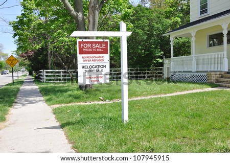 For Sale Real Estate Short Sale Relocation Sign on front yard lawn
