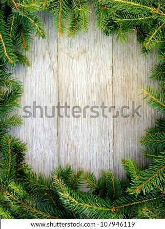 Christmas fir tree on a wooden board #107946119