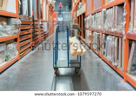 construction cart in the building store. Carts loaded with boards
