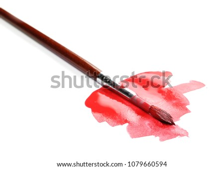 Spilled red watercolor with paintbrush isolated on white background #1079660594
