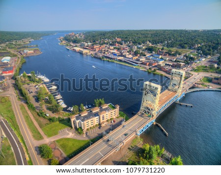 Houghton and It's Lift Bridge and located in the Upper Peninsula of Michigan #1079731220