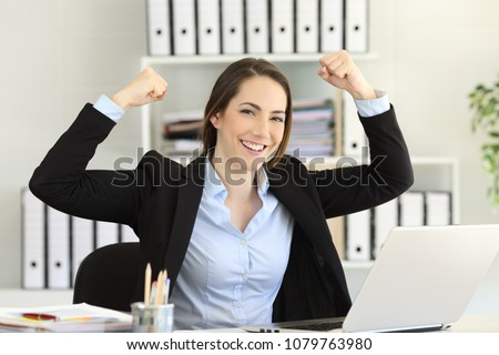 Motivated strong and confident businesswoman looking at camera at office #1079763980